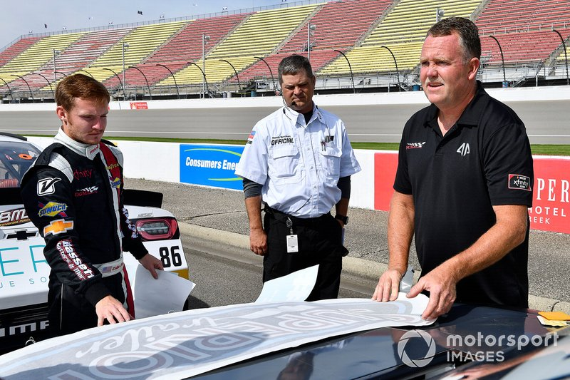 Dillon Bassett, DGM Racing, Chevrolet Camaro DGM Racing installs sponsor decals before qualifying.