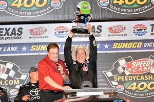 Greg Biffle, Kyle Busch Motorsports, Toyota Tundra Toyota, celebrates in victory lane.