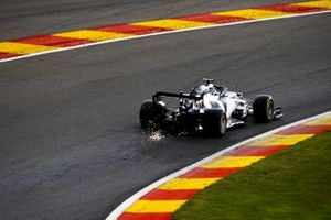 Sparks kick back from the car of Daniil Kvyat, AlphaTauri AT01