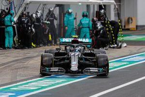 Valtteri Bottas, Mercedes F1 W11, leaves his pit box