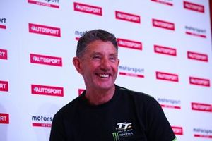 Stuart Codling talks to bike racer John Holden