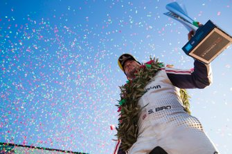 Confetti falls as Sam Bird, Envision Virgin Racing, 3rd position, celebrates on the podium