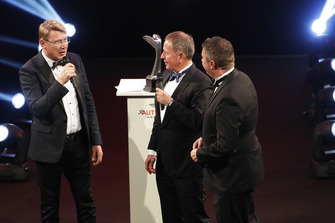 Mika Hakkinen receives a Gregor Grant Award from Martin Brundle on stage
