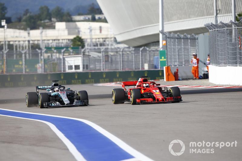 Sebastian Vettel, Ferrari SF71H, passes Lewis Hamilton, Mercedes AMG F1 W09