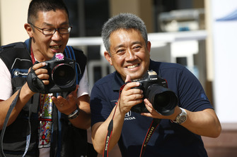 Masashi Yamamoto, General Manager, Honda Motorsport, has some fun with a photographer