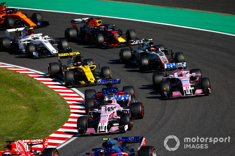 Sebastian Vettel, Ferrari SF71H, leads Pierre Gasly, Scuderia Toro Rosso STR13, Sergio Perez, Racing Point Force India VJM11, Brendon Hartley, Toro Rosso STR13, Esteban Ocon, Racing Point Force India VJM11, Carlos Sainz Jr., Renault Sport F1 Team R.S. 18, Kevin Magnussen, Haas F1 Team VF-18, Charles Leclerc, Sauber C37, Daniel Ricciardo, Red Bull Racing RB14, and Fernando Alonso, McLaren MCL33, at the start