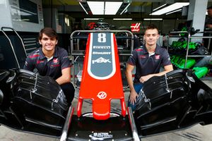Haas test and development drivers Pietro Fittipaldi and Louis Deletraz pose with a front wing and nose cone