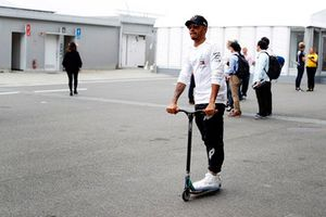 Lewis Hamilton, Mercedes AMG F1, on a scooter in the paddock