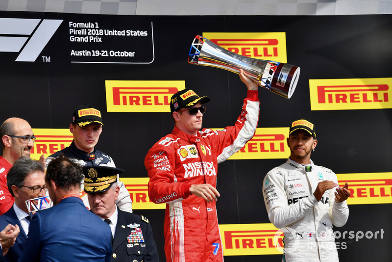 (L to R): Carlo Santi, Ferrari Race Engineer, Max Verstappen, Red Bull Racing, Kimi Raikkonen, Ferrari with the trophy and Lewis Hamilton, Mercedes AMG F1