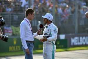 Lewis Hamilton, Mercedes AMG F1, is interviewed by Paul di Resta, Sky Sports F1, after securing pole