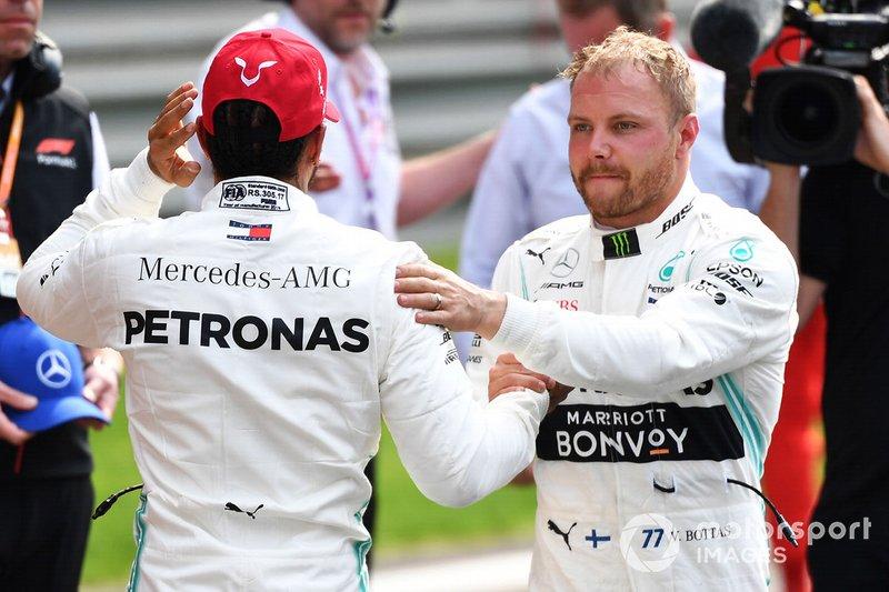 Lewis Hamilton, Mercedes AMG F1, and pole man Valtteri Bottas, Mercedes AMG F1, congratulate each other
