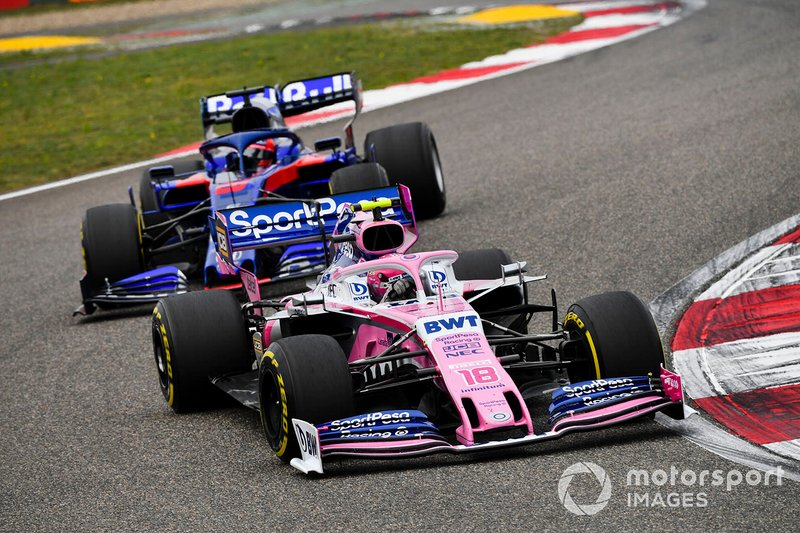 Lance Stroll, Racing Point RP19, y Daniil Kvyat, Toro Rosso STR14