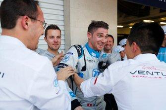 A surprised Edoardo Mortara Venturi Formula E celebrates his 3rd position with his team in parc ferme