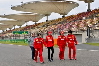 Charles Leclerc, Ferrari, walks the track