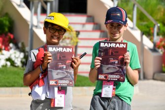 Kids in paddock with Bahrain GP Programme