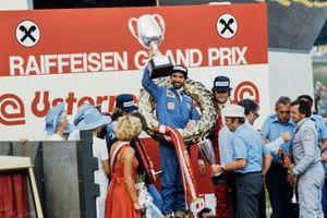 Winner John Watson celebrates victory, Jacques Laffite, Gunnar Nilsson