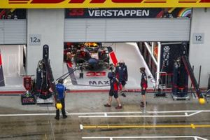 Red Bull Racing mechanics looking at the heavy rain