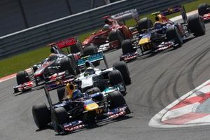 Sebastian Vettel, Red Bull RB7 Renault, Nico Rosberg, Mercedes MGP W02, Lewis Hamilton, McLaren MP4-26 Mercedes, Mark Webber, Red Bull RB7 Renault, and Fernando Alonso, Ferrari 150° Italia, into the first corner at the start
