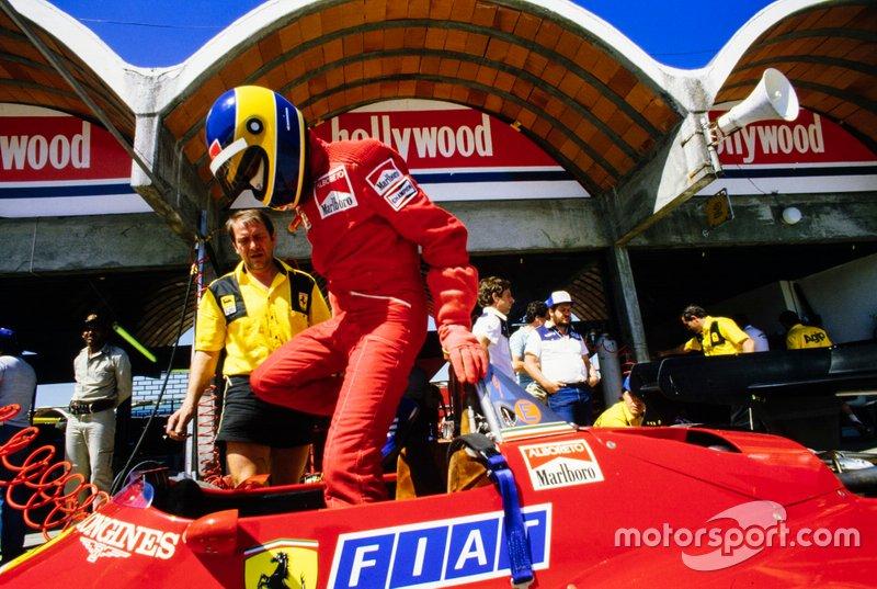 Michele Alboreto gets into his Ferrari 126C4