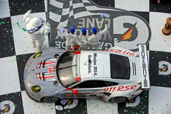 GTLM class winner in Victory Lane. #911, Porsche, 911 RSR, GTLM, Nick Tandy, Richard Lietz, Patrick Pilet