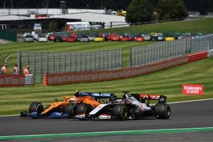 Lando Norris, McLaren MCL35, battles with Romain Grosjean, Haas VF-20