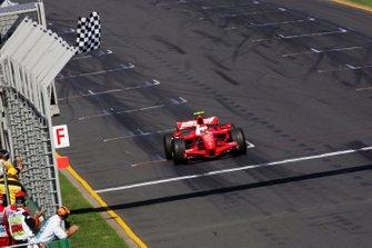 Race winner Kimi Raikkonen, Ferrari F2007 takes the chequered flag