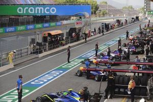 F3 Cars In The Pit Lane, Including Leonardo Pulcini, Carlin Buzz Racing And Clement Novalak, Carlin Buzz Racing