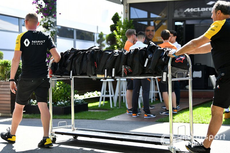 Renault personnel wheel equipment through the paddock