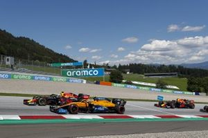 Max Verstappen, Red Bull Racing RB16, leads Lando Norris, McLaren MCL35, and Alex Albon, Red Bull Racing RB16, on the opening lap