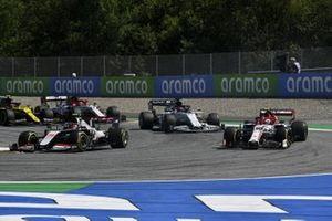 Kevin Magnussen, Haas VF-20, leads Antonio Giovinazzi, Alfa Romeo Racing C39, Daniil Kvyat, AlphaTauri AT01, and Romain Grosjean, Haas VF-20