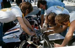 Mechanics work on James Hunt's Hesketh 308 Ford