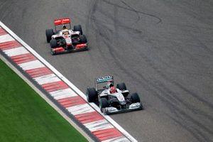 Michael Schumacher, Mercedes GP W01, leads Lewis Hamilton, McLaren MP4-25 Mercedes