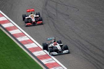 Michael Schumacher, Mercedes GP W01, leads Lewis Hamilton, McLaren MP4-25 Mercedes
