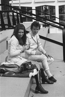 Jackie Oliver, B.R.M. P153 sits with his wife in a grandstand