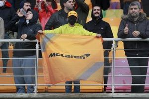 A McLaren fan with a banner in a grandstand