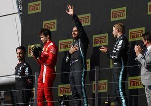 Charles Leclerc, Ferrari, 2nd position, Lewis Hamilton, Mercedes, 1st position, and Valtteri Bottas, Mercedes, 3rd position, on the podium
