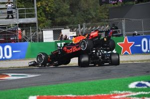 Max Verstappen, Red Bull Racing RB16B, and Lewis Hamilton, Mercedes W12, crash out
