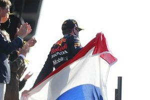 Max Verstappen, Red Bull Racing, 1st position, on thepodium with a Dutch flag cape