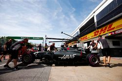 The Romain Grosjean Haas F1 Team VF-17 is wheeled back into its garage