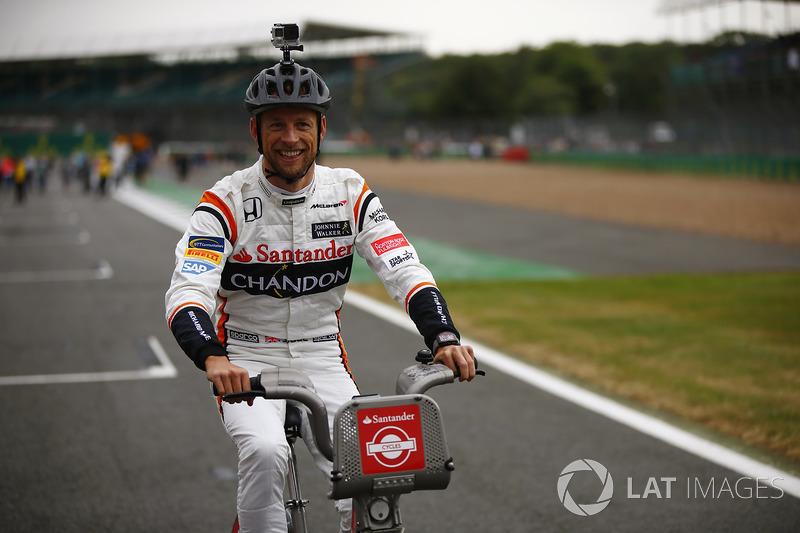 Jenson Button, McLaren, rides a bicycle