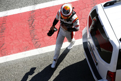 Stoffel Vandoorne, McLaren, walks back to his garage after stopping out on track