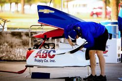 An A.J. Foyt Racing technician adjusts a sidepod wing