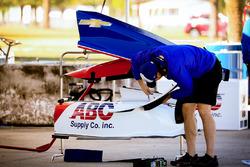 An A.J. Foyt Racing technician adjusts a sidepod wing