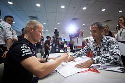 Valtteri Bottas, Mercedes AMG F1, signs autographs for his fans