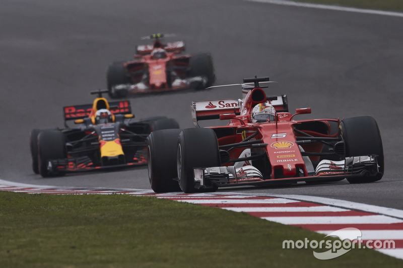 Sebastian Vettel, Ferrari SF70H, leads Daniel Ricciardo, Red Bull Racing RB13, and Kimi Raikkonen, Ferrari SF70H