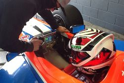 Tim Macrow runs through the MoTeC display with Anton De Pasquale as he prepares for his first run in the FT5000 car