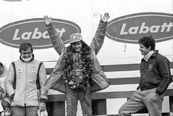 Podium: race winner Gilles Villeneuve, Ferrari, second place Jody Scheckter, Wolf, third place Carlo
