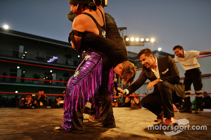 Adrian Fernandez, takes part in Lucha Libre wrestling in the paddock