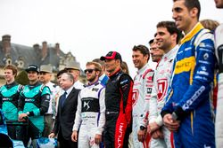 Drivers pose with the iceberg livery on a Formula E car that will be auctioned off to raise money to