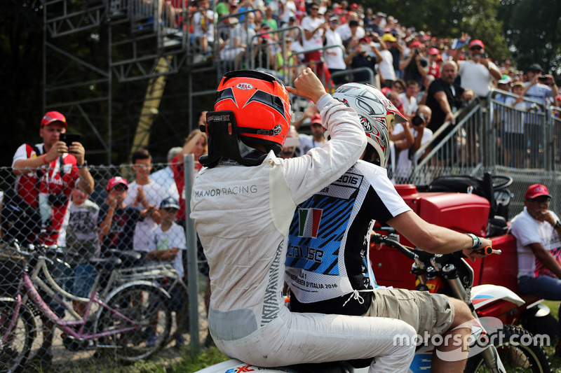 Esteban Ocon, Manor Racing rides back to the pits on a motorbike after he stopped in the second practice session